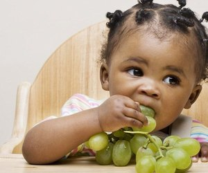 baby, child, and grapes image
