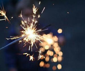 light, fireworks, and sparkler image