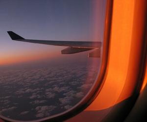 sky, orange, and plane image