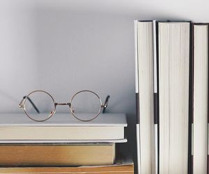 author, glasses, and books image