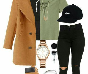 black hoodie, gold watches, and black ripped jeans image
