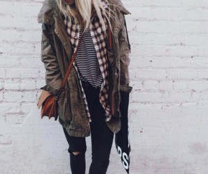 brown purse, flannel shirts, and striped t-shirt image