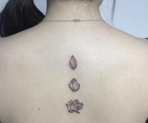 back, lotus, and tattoo image