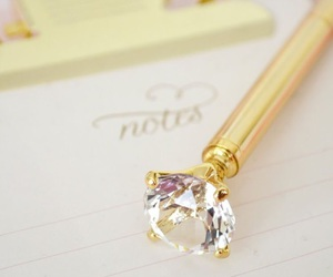 pen, diamond, and gold image