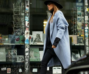 black jeans, high boots, and long coat image