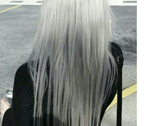 black purse, black long sleeve, and long straight silver hair image
