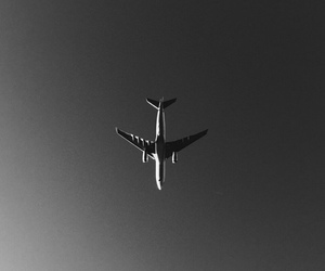 plane, sky, and black and white image