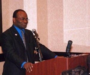 preacher, smiling, and podium image