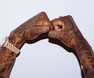 fist bump, Tattoos, and watch image