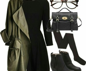black purse, brown glasses, and black knee high socks image