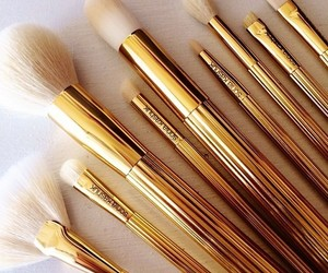Brushes, makeup, and gold image