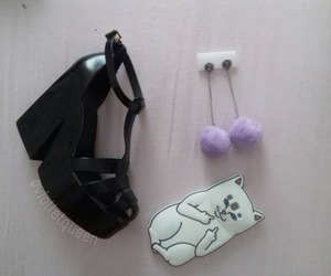 case, earings, and platform shoes image