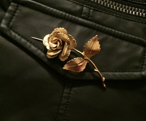 black, gold, and pins image