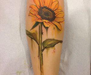 tattoo and sunflower image