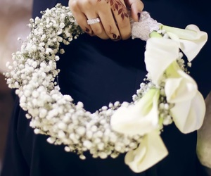 flower, hand, and ring image