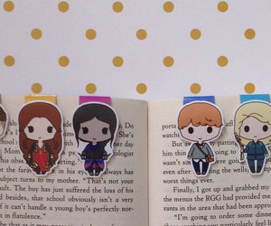 book, bookmarks, and goodies image