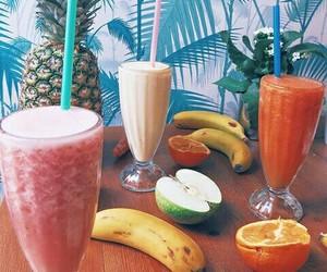 banana, manzana, and naranja image
