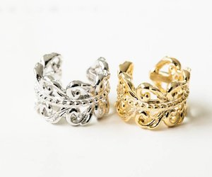 stud earrings, earcuff, and clip on earring image
