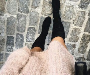 black purse, oversized sweater, and fuzzy sweater image