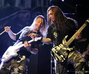 bassist, guitarist, and long hair don't care image