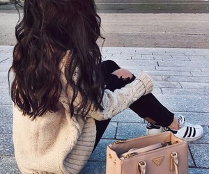 adidas sneakers, long wavy brown hair, and black ripped jeans image