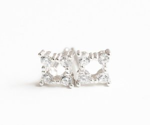 stud earrings, clip on earring, and fashion earring image