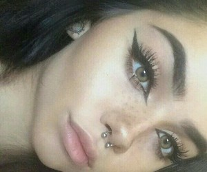 Black Eyeliner, septum piercing, and hazel eyes image