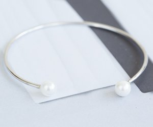 bangle, pearl brACELET, and charm bracelets image