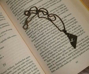 book, necklace, and rune image