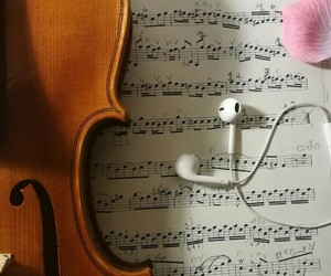 cello, earbuds, and music image