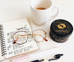 study, journal, and glasses image