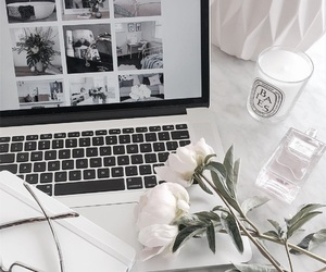 macbook, candle, and flowers image