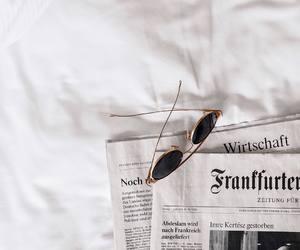 newspaper, sunglasses, and white image