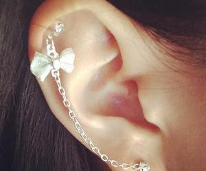 earrings, piercing, and bow image