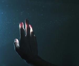 light, dark, and hand image