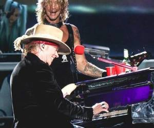axl rose, duff mckagan, and hard rock image