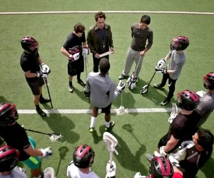 coach, field, and players image