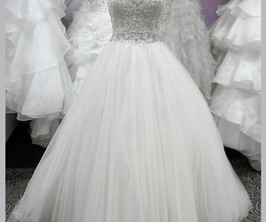 bridal gown, strapless, and wedding dress image