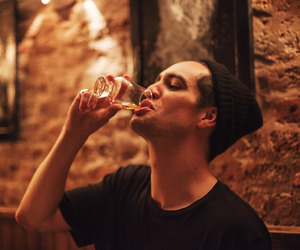 bden, drinking, and beanie image