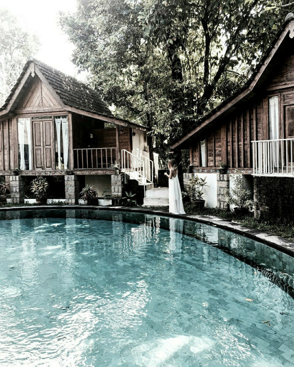 hotel, pool, and house image