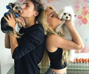 couple, dog, and puppy image