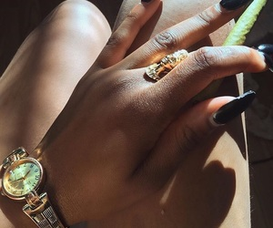 black nails, gold watch, and gold ring image