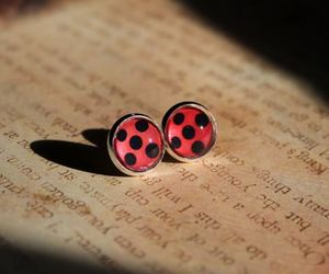 book, cartoon, and earrings image