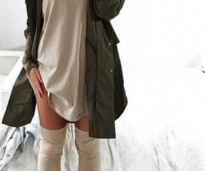 straight black hair, taupe thigh high boots, and long green jacket image