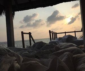 sea, bed, and sky image