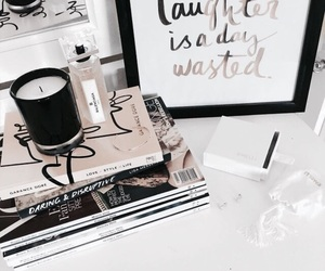 book, candle, and magazine image