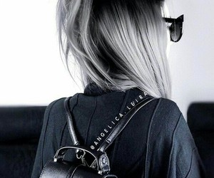 black sunglasses, black backpack, and long straight silver hair image