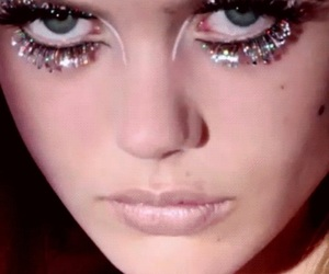glitters, makeup, and sad eyes image