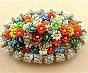 flower brooches, colorful flower brooch, and beaded flower brooches image