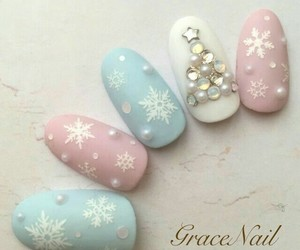 christmas nails, pastel pink nails, and white almond nails image